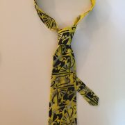 Yellow silk tie with black fan design